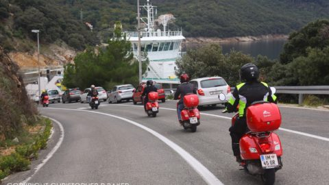 Vespas approach ferry to Krk on Croatia by Scooter tour with Edelweiss Bike Travel; copyright Christopher P Baker