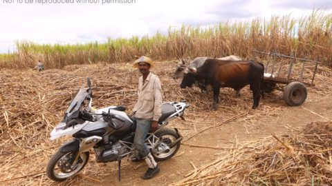 Sugarcane worker on BMW 1200GS near Guantanamo, Cuba; copyright Christopher P Baker