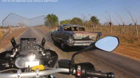 BMW R1200GS passing a 1950s Oldsmobile in Cuba; copyright Christopher P Baker