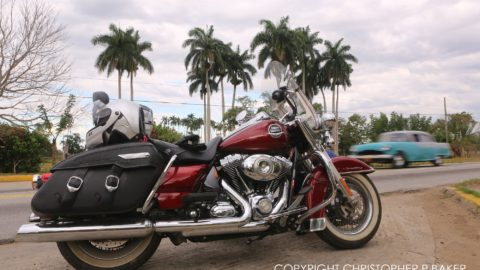 Harley-Davidson and 1950s classic car, Cuba; copyright Christopher P Baker